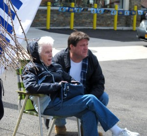 These folks enjoy ringside seats to the demolition, across the street at the gas station.