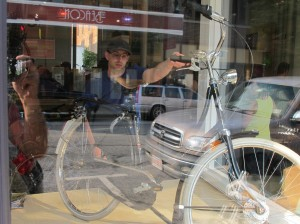 Owner Jon Miles puts the Gazelle back in the window for safekeeping.